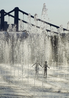 Kids playing in the fountain
